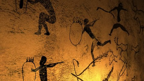 Candelight fire dances over cave paintings in prehistoric cavern