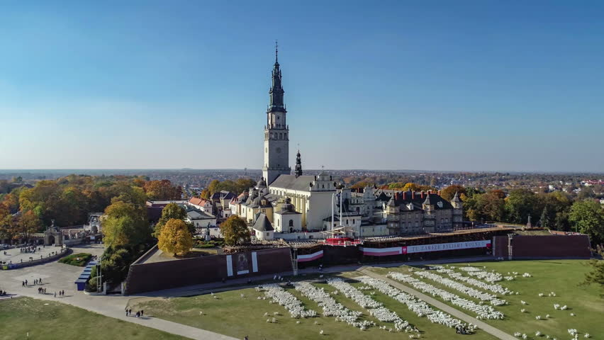 Poland, Czestochowa. Jasna Gora fortified monastery and church on the hill. Famous historic place and Polish Catholic pilgrimage site with Black Madonna miraculous icon. Aerial 4K flyby video in fall