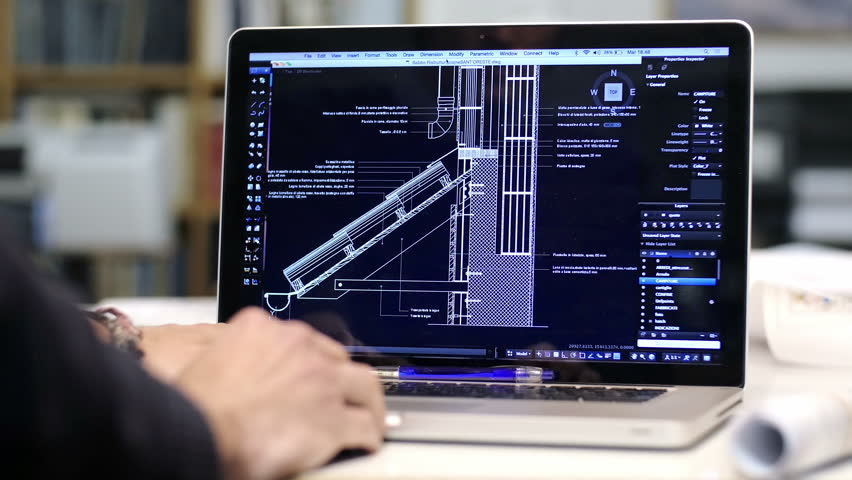 Architect at work with a cad software with a laptop computer