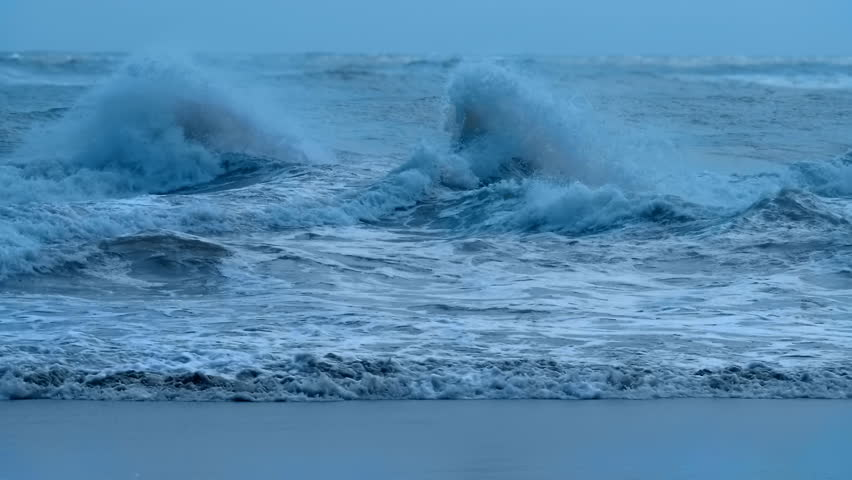 Stormy sea with big blue waves with foam whitecaps and splashes. Large waves in a windy turbulent ocean. Slow mo, slo mo, slow motion, high speed camera, 240fps, 250fps | Shutterstock HD Video #1022226616