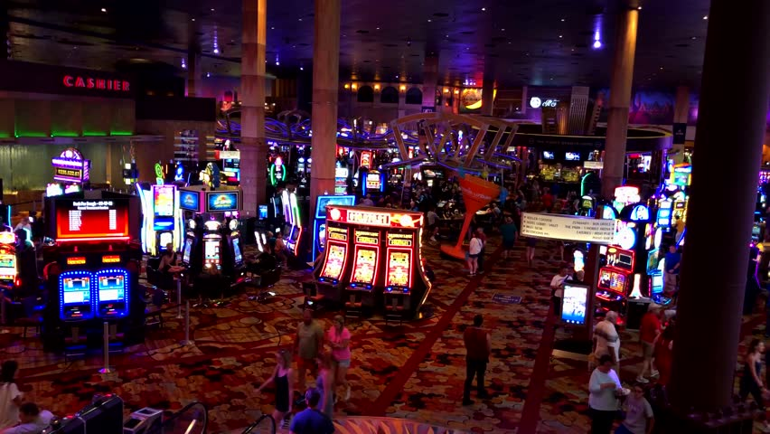 Las Vegas, USA - September 10, 2018: People are playing slot machines at MGM casino