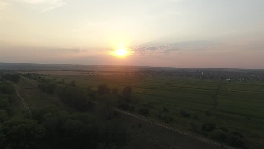 Beautiful sunset. Evening nature, clear sky, green fields shot by drone. | Shutterstock HD Video #1022242186