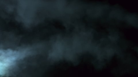 Atmospheric smoke 4K Fog effect.  VFX Element. Haze background. Abstract smoke cloud. Smoke in slow motion on black background. White smoke slowly floating through space against black background. Mist