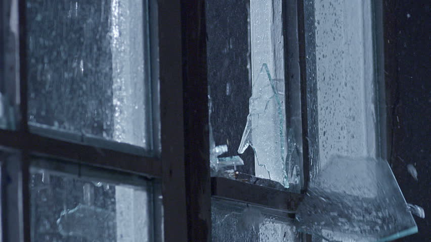 Window glass breaking during bad rainy weather . Plate glass window shattering . Thunder Through The Window . Heavy Rain Drops Sliding Down On Window Glass . Shot on Red Epic camera in slow motion .