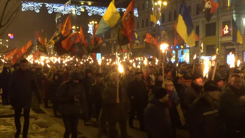 Torchlight procession (torch march) of Ukrainian nationalists with a portrait of their leader Bandera. Kiev, Ukraine. January 1, 2019 #1022344906