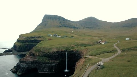 Fly Over Gasadalur village and Beautiful  waterfall, Vagar, Faroe Islands, Denmark.