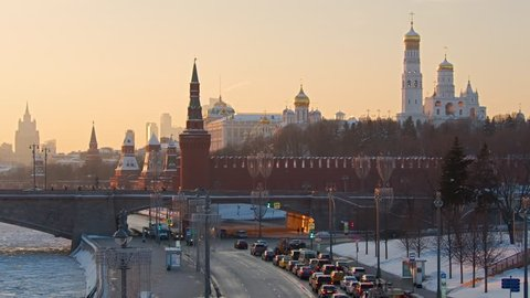 MOSCOW - FEBRUARY 2018: City traffic near the Kremlin at sunset time in Moscow, Russia