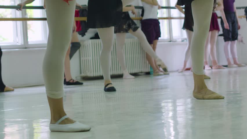 Cluj-Napoca/Romania - May 15, 2016: Editorial slow motion shot of real ballet dancers in class during practice. Warm-up | Shutterstock HD Video #1022535316