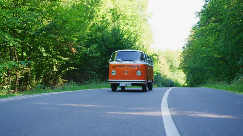 Road trip with an orange VW bus.