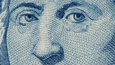 Christopher Columbus portrait on Bahamas banknote macro slow rotating. Stock video footage