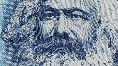 Karl Marx on East German banknote macro slow rotating. Philosopher, economist, sociologist, socialist. Founder of marxism and communism. Stock video footage