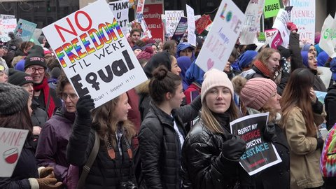 WASHINGTON, DC - JAN. 19, 2019: Close on passing, chanting marchers among the thousands of demonstrators in Women's March of 2019 making their presence known.