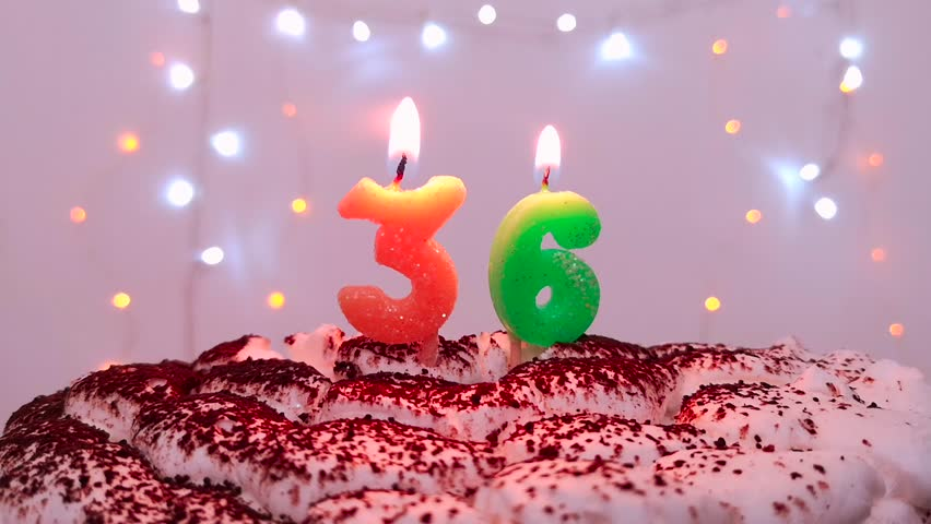 Burning Birthday Candle On A Cake Number 36 Blow Out At The End Color Blurred Background