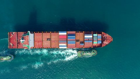 Aerial top view Tug boat drag container ship to ware house for logistic, import export or transportation.