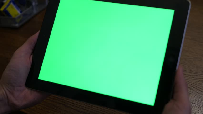 boy holding a tablet pc with green screen #1022740606