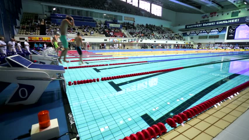 moscow russia april 19 2015 athletes starts to swim backstroke during championship of russia on swimming in olympic sports complex
