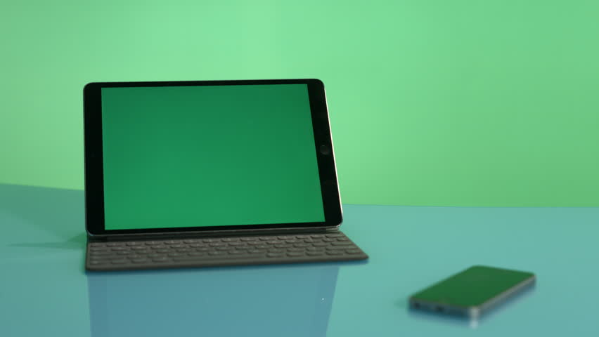 Tablet with  green screen on a green background | Shutterstock HD Video #1022757256