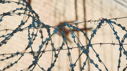 fence prison closed area strict regime silhouette barbed wire. illegal immigration fence from refugees. illegal immigration concept prison lifestyle a prison fence