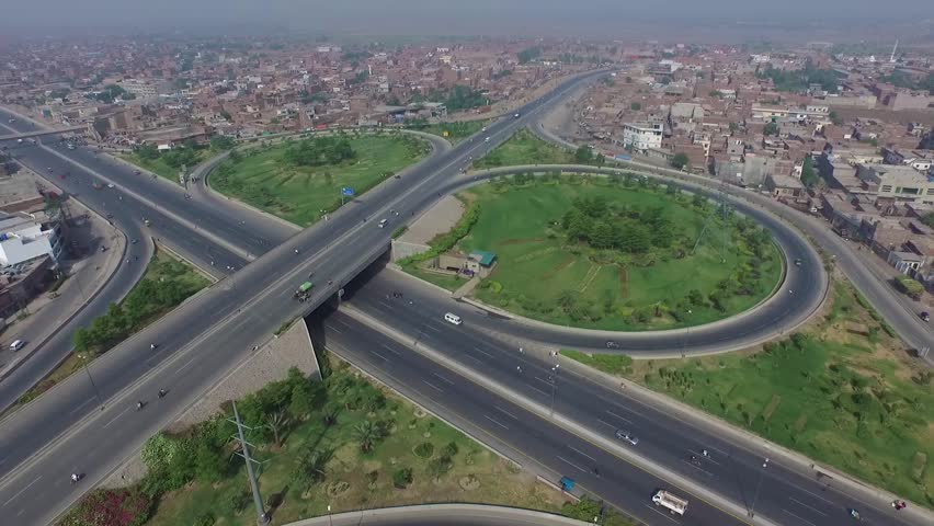 Aerial view of people commuting on the busy ring road in Lahore, Pakistan | Shutterstock HD Video #1022842336