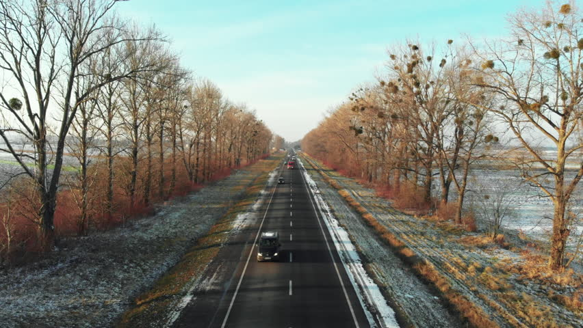 Aerial view of the road in the wonderful countryside in winter on sunny day. Landscape with drone. | Shutterstock HD Video #1022842666