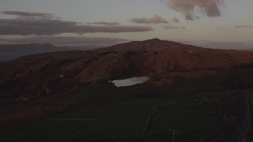 Drone shot irealnd over pond and sheep | Shutterstock HD Video #1022844406