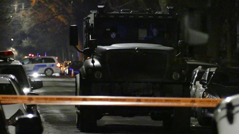 Montreal, Quebec, Canada - April 15th 2018 - Armored police truck parked in the night during high risk standoff operation