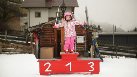 Portrait Of Young Preschool Girl. She Stand On Podium And Posing.