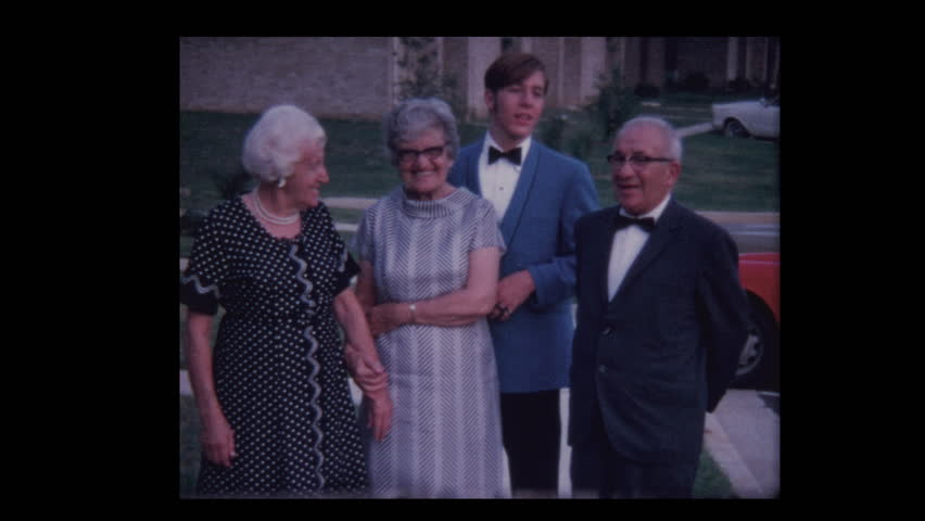 1971 Graduation boy in blue tuxedo poses with grandparents | Shutterstock HD Video #1023000526