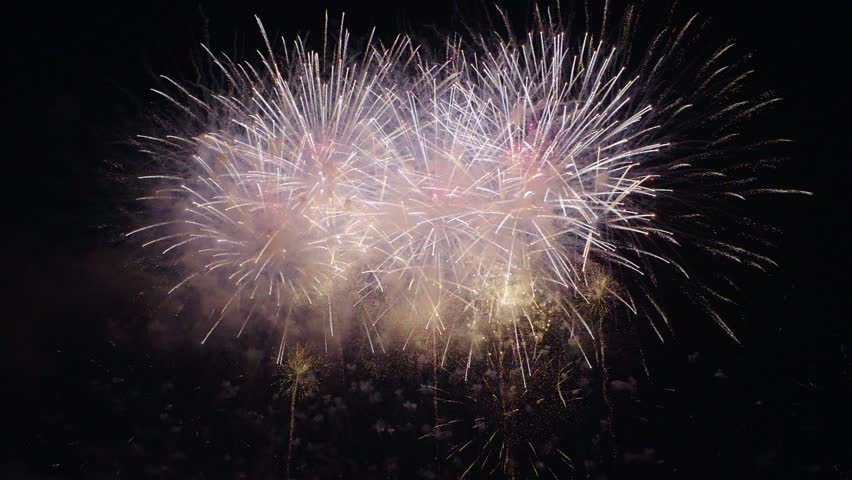 Spectacular fireworks exploding over a night sky. PANNING RIGHT. | Shutterstock HD Video #1023040696