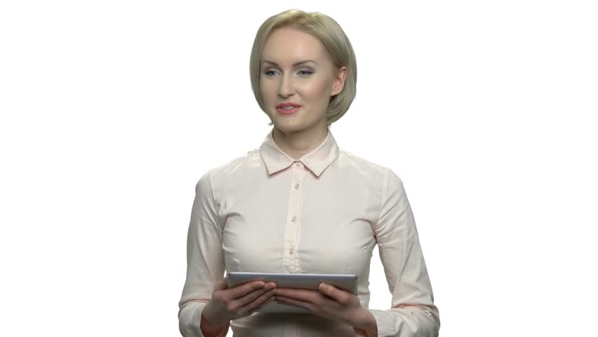 Attractive business woman giving a lecture. Pretty business coach giving a presentation to audience using tablet device. Isolated on white background.   Shutterstock HD Video #1023073366