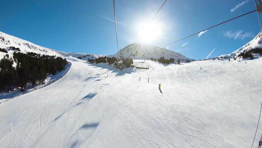 Winter mountains on a bright sunny day. Canillo ski region, Andorra