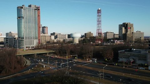Tysons, VA / USA - December 29 2018: Slow rising dolly showing the Tysons Corner skyline over the intersection of Leesburg Pike and Chain Bridge Road