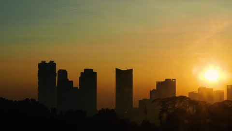 JOHOR BAHRU, JOHOR / Malaysia - 09 23 2018: Sunrise Timelapse in Johor Bahru City in Malaysia