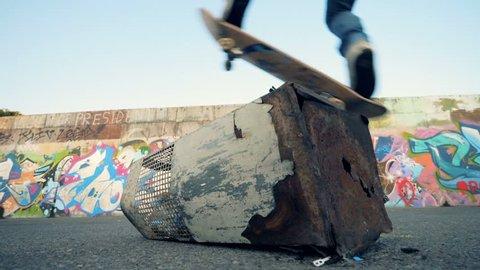 A skateboarder doing stunts, slow motion.
