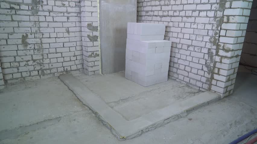 tilt down view of prepared area for setting a new brick wall