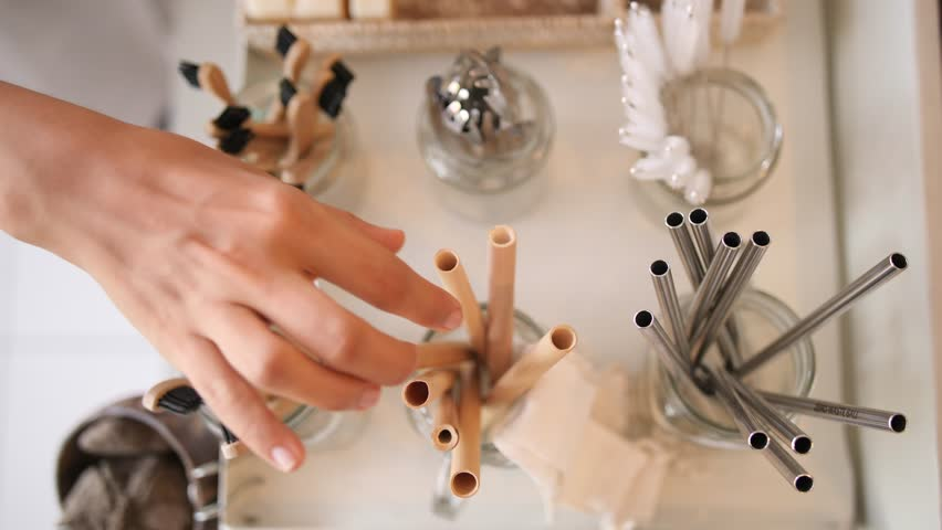 Woman Buying Bamboo Eco Friendly Biodegradable Wooden Cocktail Straw in Zero Waste Shop. No plastic Conscious Minimalism Vegan Lifestyle. Reduce Reuse Recycle 4K Slowmotion Concept. | Shutterstock HD Video #1023292186