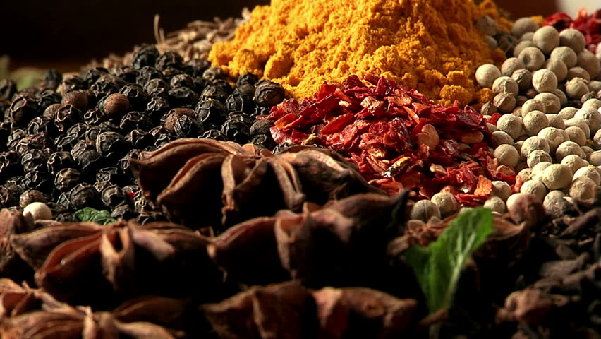 The palette of different food spices. Macro