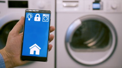Smart home app on mobile phone wirelessly controls washing machine