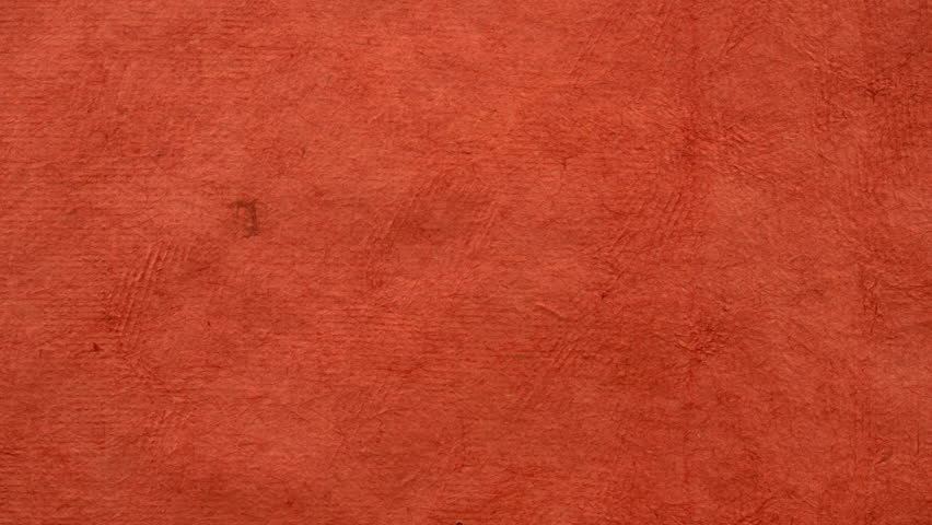 background of pumpkin red handmade Huun paper created by Mayan artisans in Mexico from a tree bark - horizontal pan #1023385336