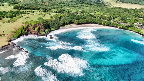 Stunning aerial drone footage of Hamoa Beach, a remote beach near the little town of Hana on the east side of the island of Maui, Hawaii. Hamoa Beach is consistently named one of Maui's Best Beaches.