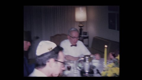 1971 Grandfather leads prayer over wine at Passover seder