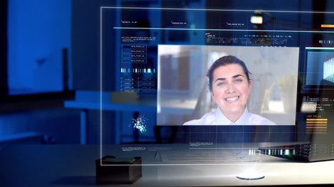 business, deadline and communication concept - video conference with businesswoman on virtual screen at night office