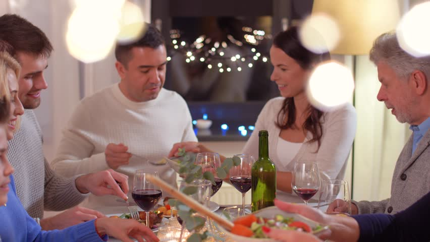 Celebration, holidays and people concept - happy family having dinner party at home | Shutterstock HD Video #1023663316
