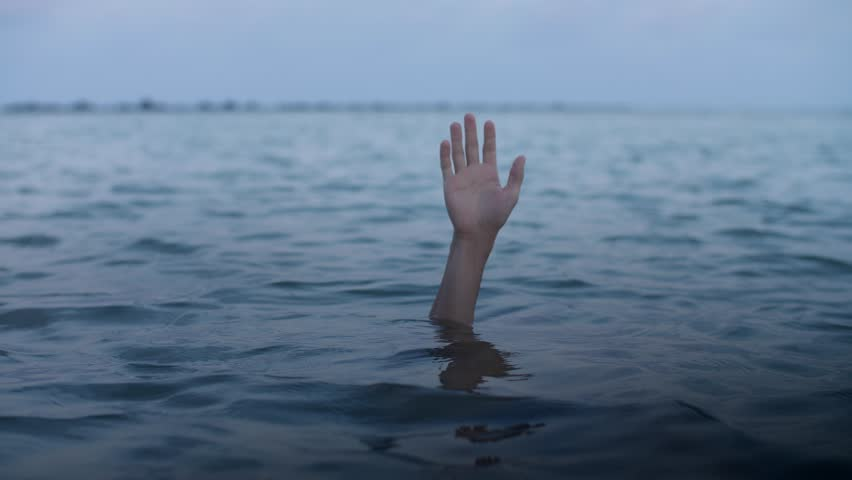 Hand of a drowning man sinks into the water, concept of a person mired in debt and unable to help himself   Shutterstock HD Video #1023756316