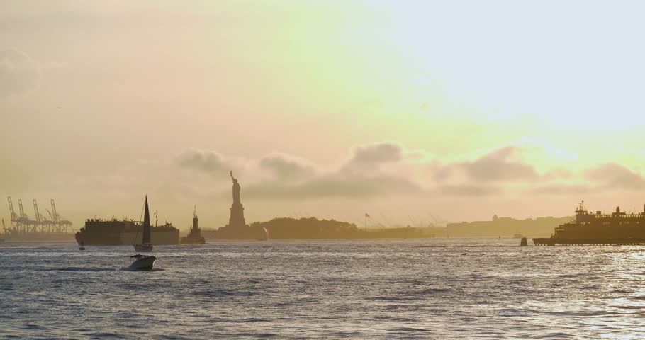 Sunset Over the Statue of Liberty, New York City Skyline NYC Hudson River