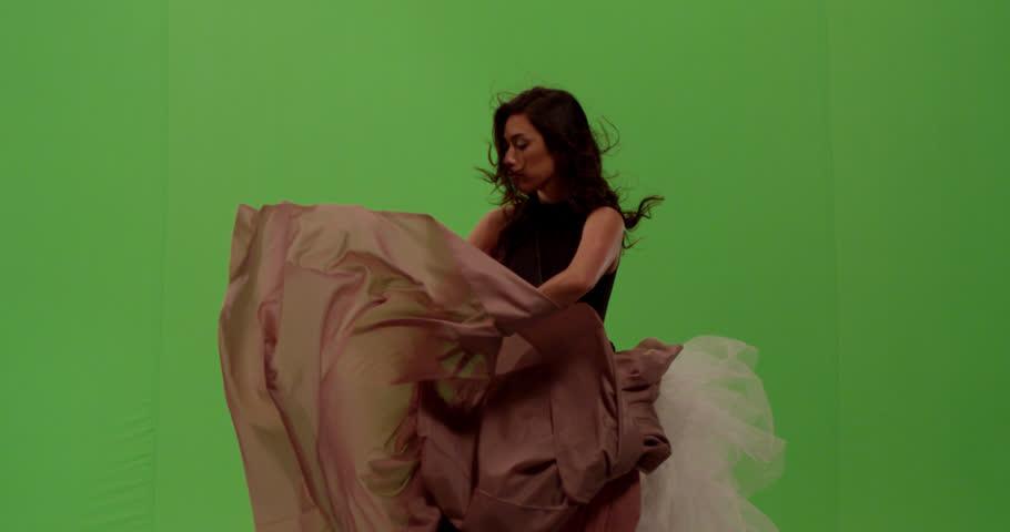 Beautiful mixed race asian white woman fashion model dancer posing against green screen | Shutterstock HD Video #1023831256