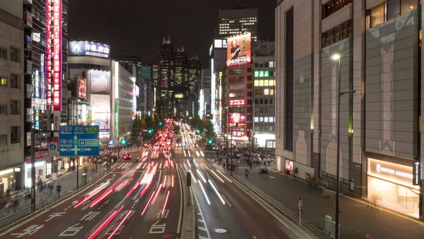 TOKYO, JAPAN - 2018 circa: Traffic passes through the Shinjuku District. The district is the main commercial and administrative center of the city. 4K time lapse | Shutterstock HD Video #1023906226