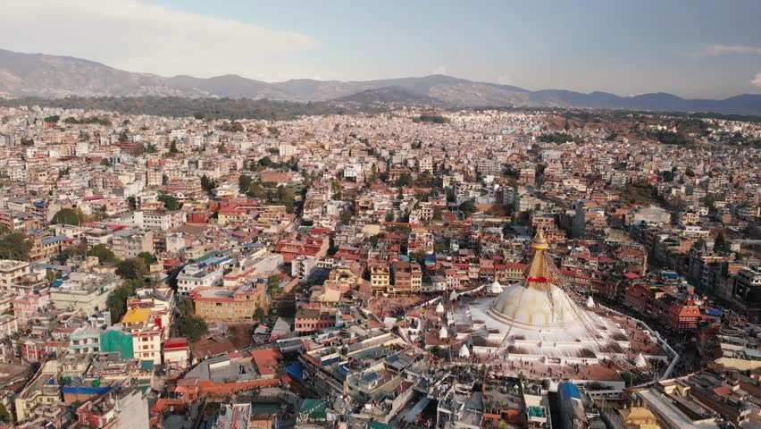 Aerial view on houses of Kathmandu, Nepal. Aerial view of white Boudhanath stupa. | Shutterstock HD Video #1023907366