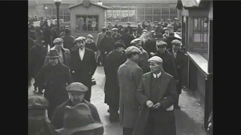 CIRCA 1920s - Workers arrive at a factory in 1927.