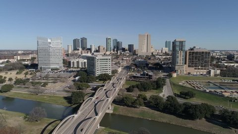 Static aerial shot of the Fort Worth, Texas skyline from over the 7th Street Bridge.